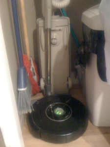The roomba snuggled up to the electrolux