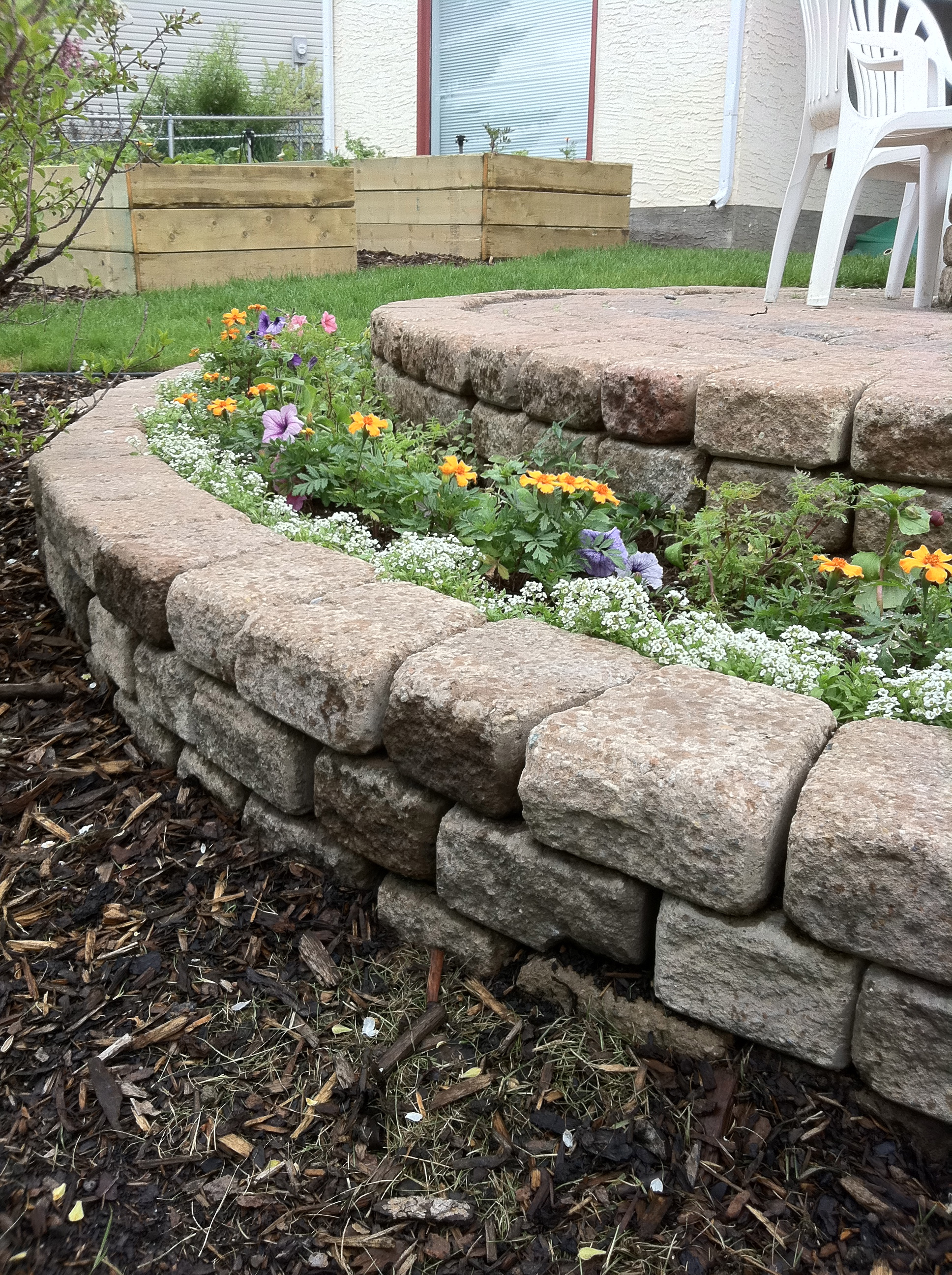build a stacked stone flower bed in a few hours hope for. Black Bedroom Furniture Sets. Home Design Ideas